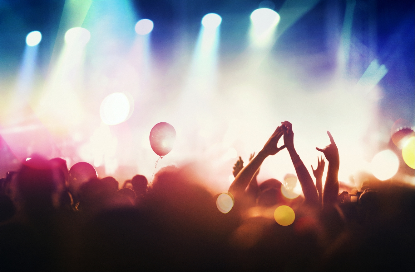 Concert with a crowd of people in bright lights