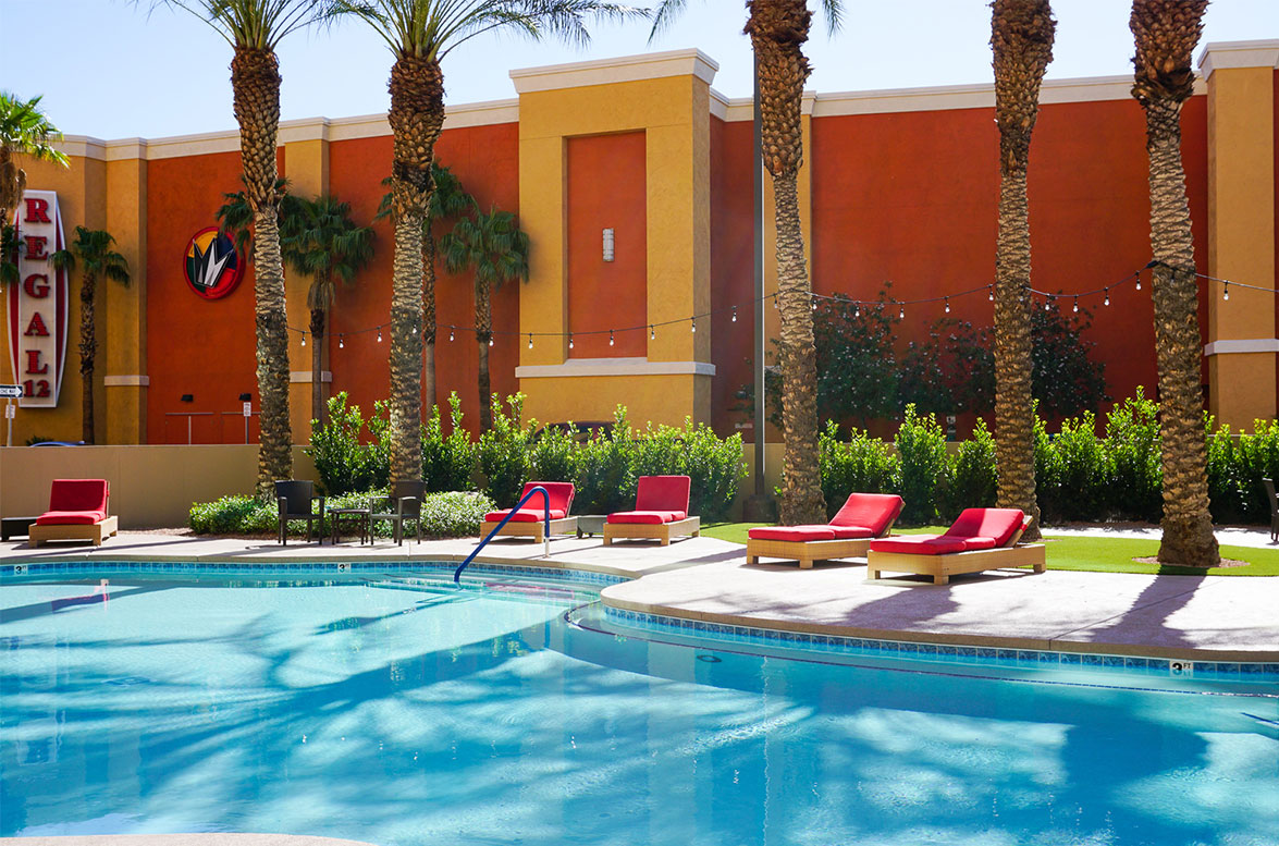 Fiesta Henderson pool with red cushion day beds