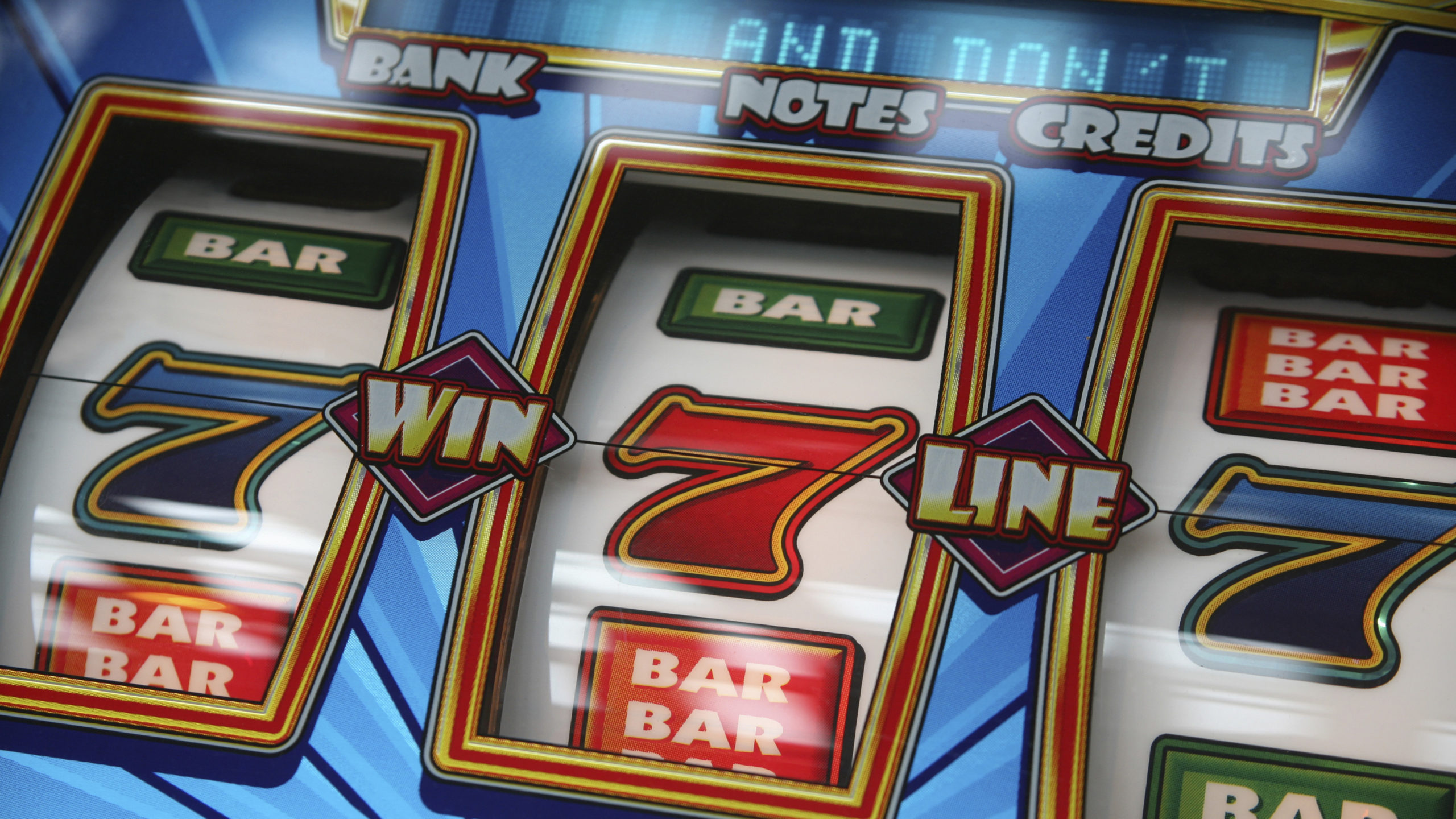 Slot machine showing three sevens
