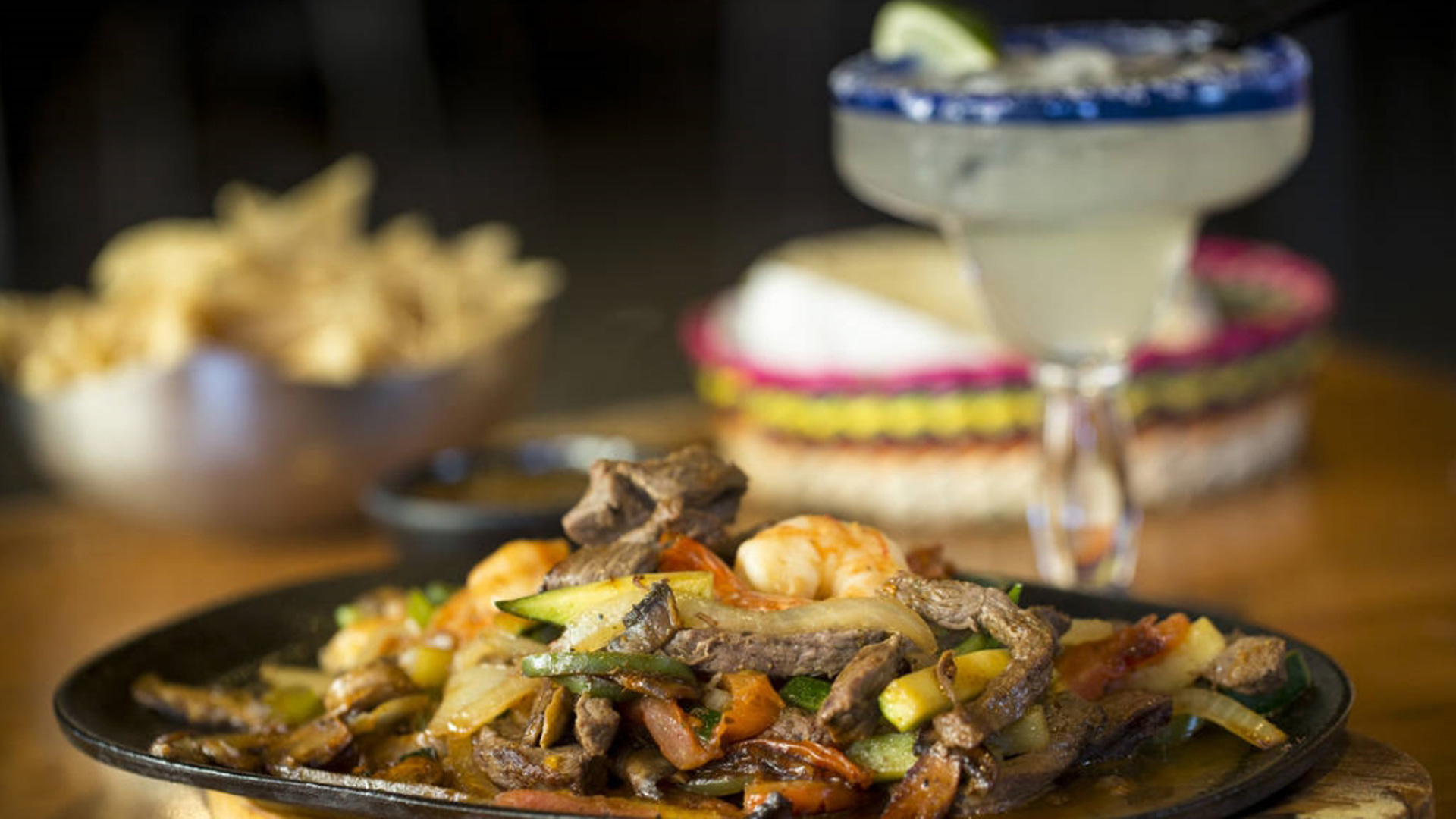 close up of fresh fajitas and a margarita