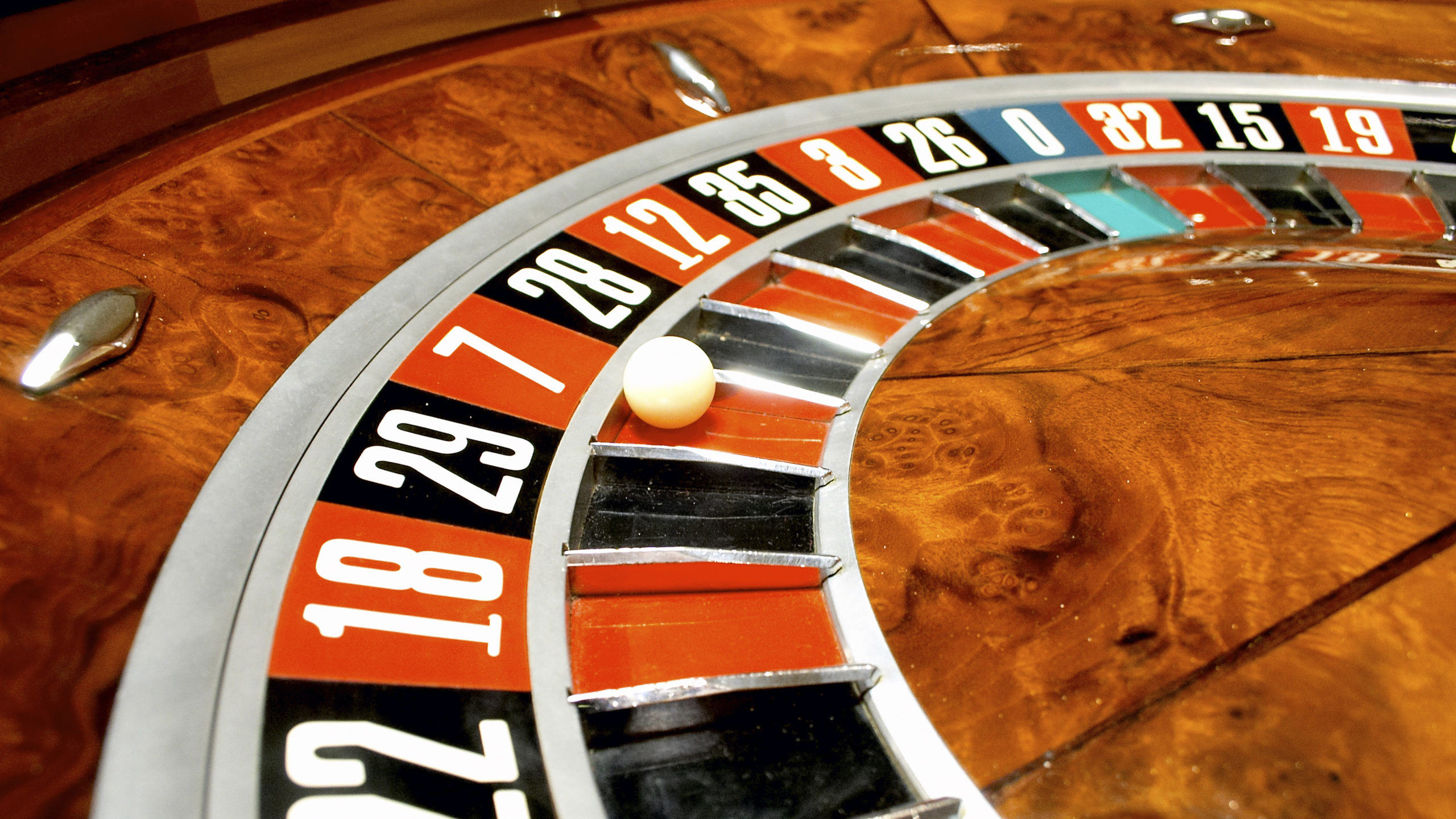 Close up of Roulette Wheel with white ball in seven red